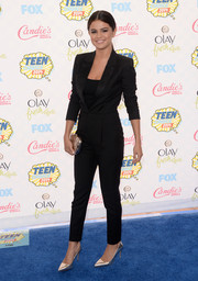 Selena Gomez kept it sleek and elegant at the Teen Choice Awards in a black tux-style jumpsuit by Saint Laurent.