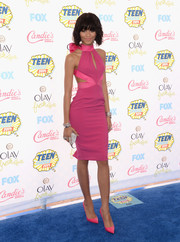 Zendaya Coleman looked impossibly slim in a pink Material Girl halter dress with side cutouts and a keyhole neckline during the Teen Choice Awards.