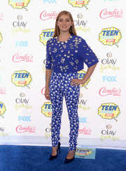 Willow Shields opted for a pair of blue and white tulip-print pants, also by Emanuel Ungaro, to team with her top.