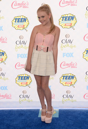 Emily Alyn Lind worked the Teen Choice Awards blue carpet in a super-sweet pink and white strapless mini with a bowed belt.