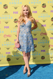 Dove Cameron's pink oval clutch and blue dress made a pretty color combo.