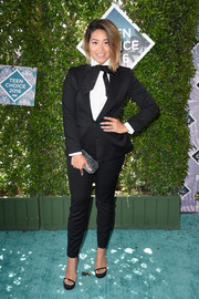 Gina Rodriguez complemented her outfit with black slim-strap platform sandals by Stuart Weitzman.