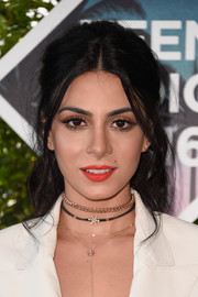 Emeraude Toubia was edgy-glam at the Teen Choice Awards wearing this messy half-up 'do.