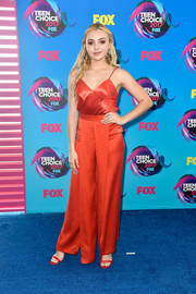 Peyton List matched her top with red silk palazzo pants, also by Bec & Bridge.