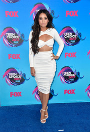 Janel Parrish finished off her dress with a pair of complementary sandals by Stuart Weitzman.