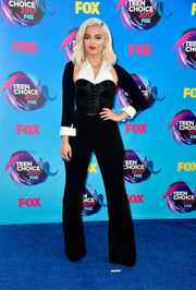 Black flare pants completed Bebe Rexha's ensemble.