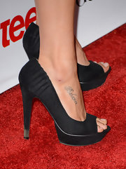 Phoebe Tonkin showed off her lettering tattoo in a pair of peep-toe heels.