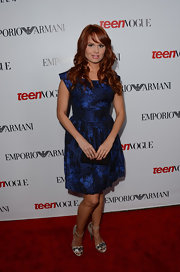 Debby Ryan shined on the red carpet in this rich midnight blue brocade dress.