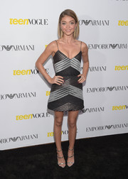 Sarah Hyland kept the shimmer going with a pair of silver strappy sandals by Giuseppe Zanotti.