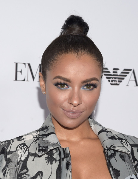 Kat Graham downplayed her lips with a nude hue.