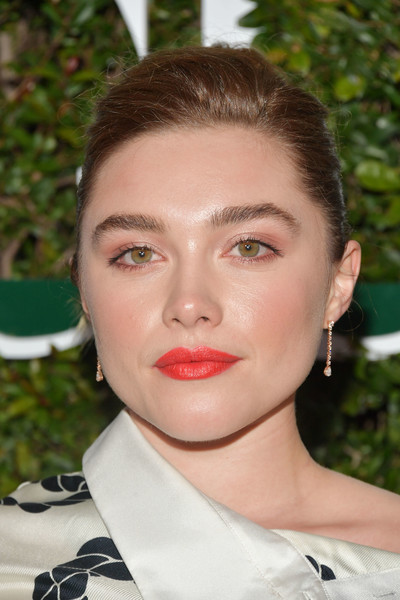 Florence Pugh attended the 2019 Teen Vogue Young Hollywood Party wearing her hair in a side-parted bun.