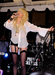 Taylor sports black punky studded leather cuffs as she performs with her band.