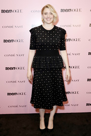 Greta Gerwig donned a studded black peplum dress by Michael Kors for the 2019 Teen Vogue Summit.
