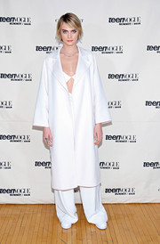 Cara Delevingne attended the Teen Vogue Summit wearing a white duster and matching trousers.
