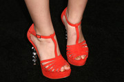 A pair of bright orange platform sandals added a dose of rich color to Joey King's look during the Teen Vogue Young Hollywood party.