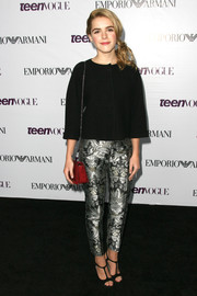 Kiernan Shipka looked chic and all grown up in a loose black blouse and print pants at the Teen Vogue Young Hollywood party.