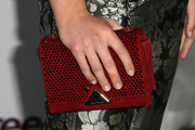Kiernan Shipka added a splash of color to her monochrome outfit with a crystal-studded red chain-strap bag when she attended the Teen Vogue Young Hollywood party.