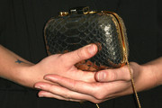 Hannah Taylor Gordon carried a tiny gold snakeskin-patterned purse when she attended the Teen Vogue Young Hollywood party.