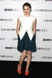 Joey King looked smart and feminine in a fitted white blouse with a geometric hem teamed with a flared skirt during the Teen Vogue Young Hollywood party.