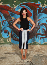 Megan Fox dressed up her top with a two-tone zip-front pencil skirt.