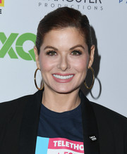 Debra Messing pulled her hair back into a side-parted ponytail for the Telethon for America.