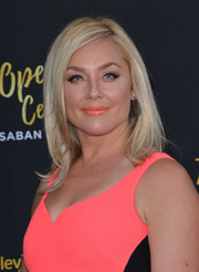 Elisabeth Rohm looked like Barbie with her perfect platinum-blonde hair at the Television Academy's 70th anniversary gala.