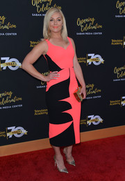 Elisabeth Rohm couldn't be missed in her neon-pink and black midi dress at the Television Academy's 70th anniversary gala.