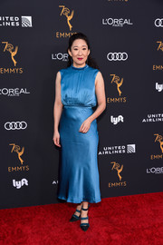 Sandra Oh attended the Television Academy Emmy nominees party wearing a sleeveless blue satin dress.