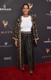 Tracee Ellis Ross went for exotic glamour with this intricately embroidered coat by Chanel at the Television Academy's performers peer group celebration.