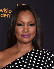 Garcelle Beauvais left her hair loose in a sleek straight style when she attended the Television Academy and SAG-AFTRA Dynamic and Diverse celebration.