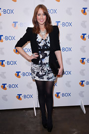Lizzy paired her black blazer with a printed cocktail dress and black tights.