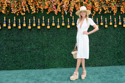 Jessica Hart continued the summery vibe with a pair of raffia wedges.