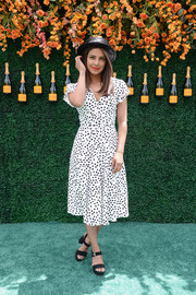 Priyanka Chopra was classic in a black-and-white dotted dress by Altuzarra at the Veuve Clicquot Polo Classic.