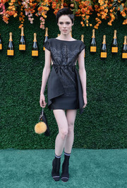 Coco Rocha hit the Veuve Clicquot Polo Classic wearing an elegant empire-waist LBD by Fendi.