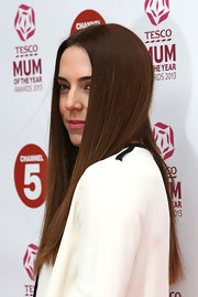 Mel C was totally chic with sleek straight tresses and a center part.