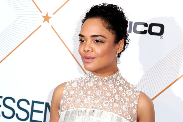 Tessa Thompson Curly Updo [red carpet,skin,eyebrow,beauty,hairstyle,forehead,fashion accessory,neck,makeover,smile,black hair,tessa thompson,beverly hills,california,regent beverly wilshire hotel,essence black women in hollywood oscars luncheon]