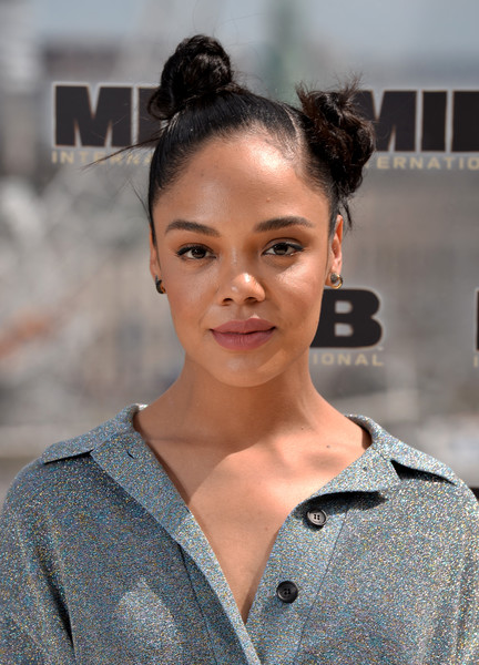 Tessa Thompson Hair Knots [men in black: international london photocall,hair,face,hairstyle,beauty,eyebrow,fashion,chin,lip,photography,bun,tessa thompson,photocall,london,england,corinthia hotel]