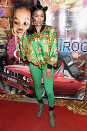 Teyana Taylor was casual-chic in a chain-print bomber jacket by Chanel at the grand opening of her Junie Bee Nail Salon.