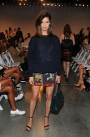 Hanneli Mustaparta kept cozy in a quilted blue eagle-embroidered sweater during the Thakoon fashion show.