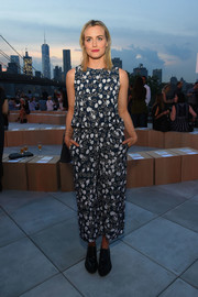 Taylor Schilling kept it relaxed in a cropped floral jumpsuit by Thakoon when she attended the label's fashion show.