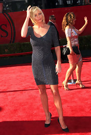 Jaime Pressley toned down the sexy vibe of her glittery sweater dress with a pair of subdued black satin pumps.