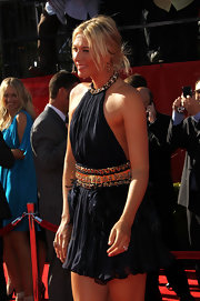 Tennis darling Maria Sharapova paired her Alexander McQueen dress with a casual and messy updo.