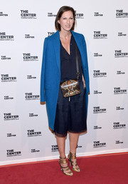 Underneath her coat, Jenna Lyons sported a pair of navy culottes and a casual blouse.