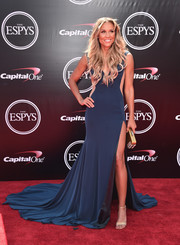 Lolo Jones looked flawless in a JOVANI dress that she styled with a Devi Kroell clutch, Tacori jewelry, and strappy Rene Caovilla heels at the 2016 ESPY Awards.
