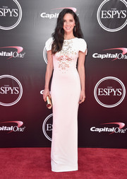 Olivia Munn completed her modern ensemble with an angular gold clutch by Lee Savage.