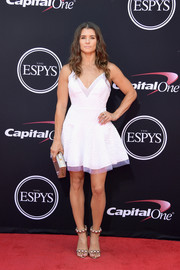 Danica Patrick polished off her look with a pair of embellished gold sandals by Alaia.