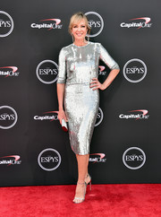 Allison Janney completed her shimmering ensemble with a metallic clutch by Jimmy Choo.