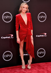 Nastia Liukin worked a red velvet mini dress with a plunging neckline and a draped fabric accent at the 2018 ESPYS.