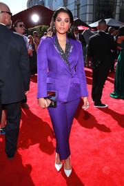 Lilly Singh completed her ensemble with a mirrored silver clutch.