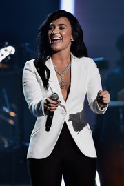 Demi Lovato's diamond pendant necklace gave her blazer a heavy dose of glamour at the 2016 Grammys.